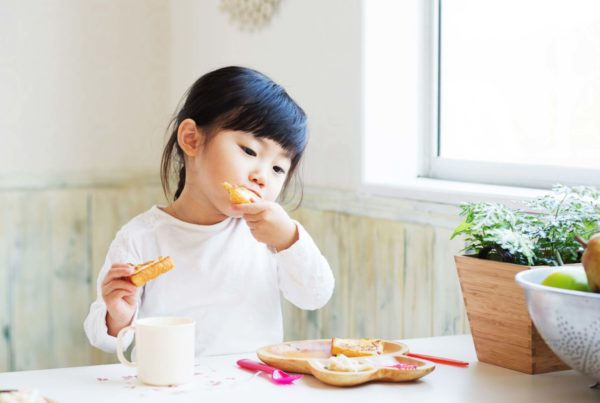 japanese child eating bread